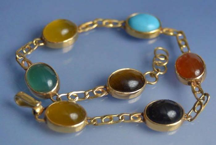 Bracelet d'occasion or et pierres fines