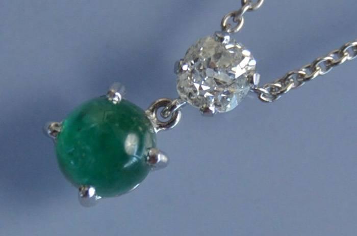 Collier d'occasion émeraude et diamants