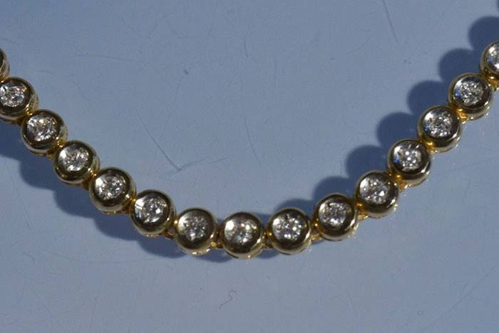 Collier diamants en serti clos