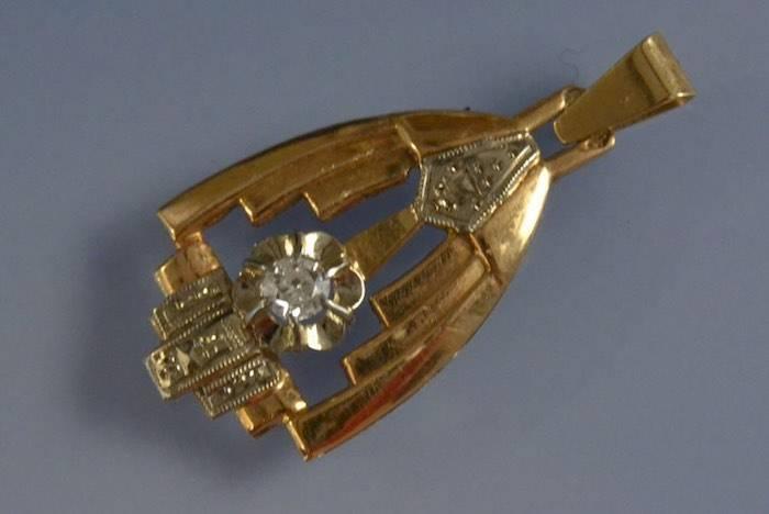 Pendentif or, platine et diamant