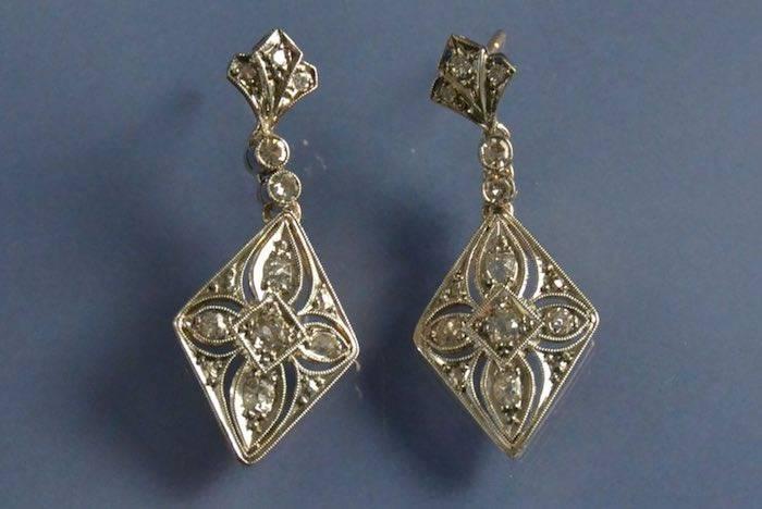 Boucles d'oreilles deux ors et pavage diamants
