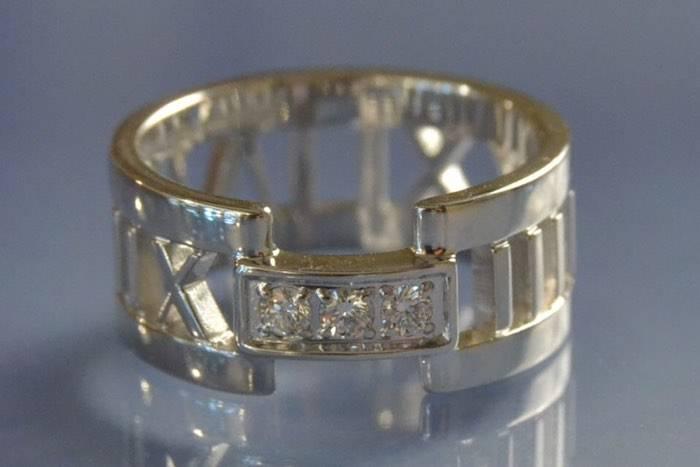 Bague Tiffany or blanc et diamants