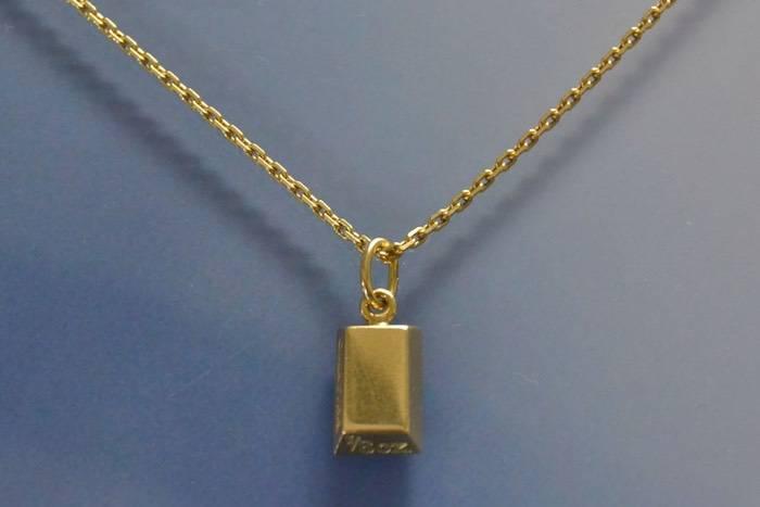 """Collier et pendentif ''lingot"""" signé Cartier"""