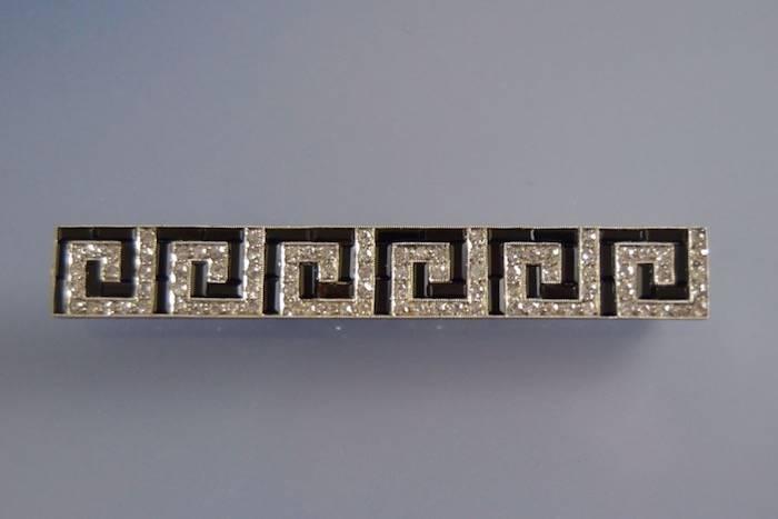 Broche art déco platine onyx et diamants